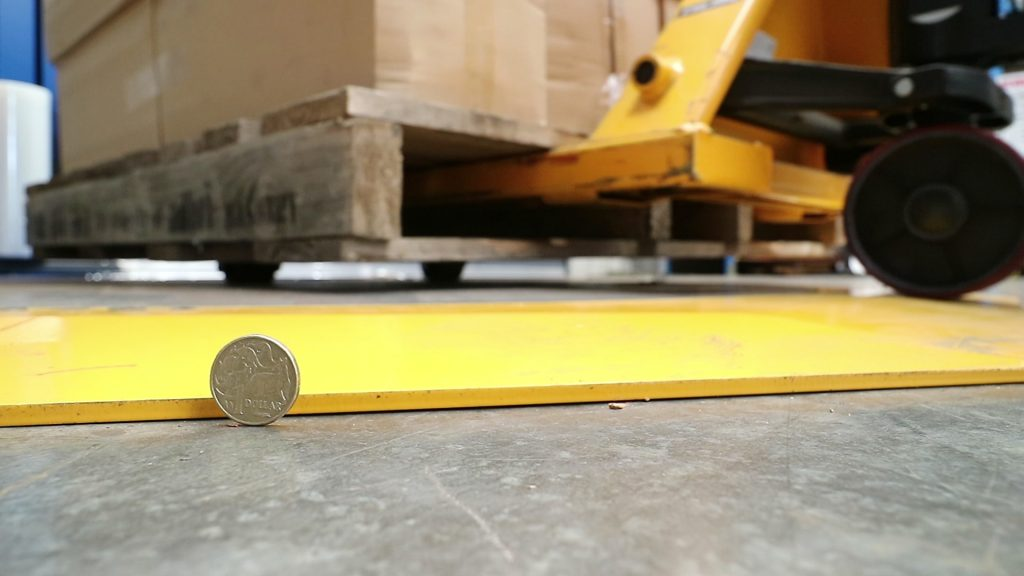 Hand-loading-pallet-on-plana-with-coin