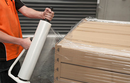 The Correct Way to Hand Stretch Wrap a Pallet (and Why its so Important)